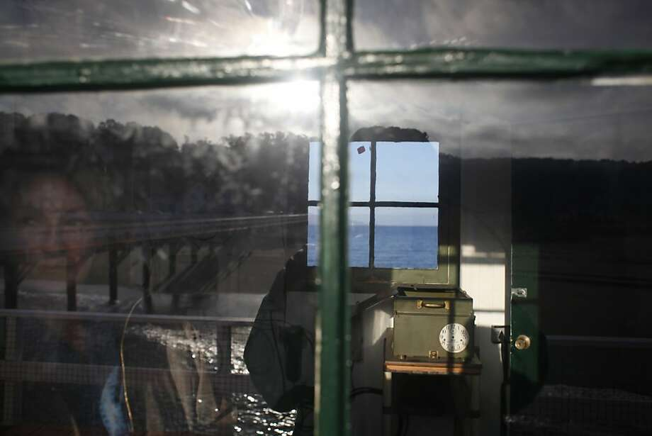 Mary Jane Schramm of the National Oceanic and Atmospheric Administration looks at the shore from the S.F. tide station. Photo: Mike Kepka, The Chronicle