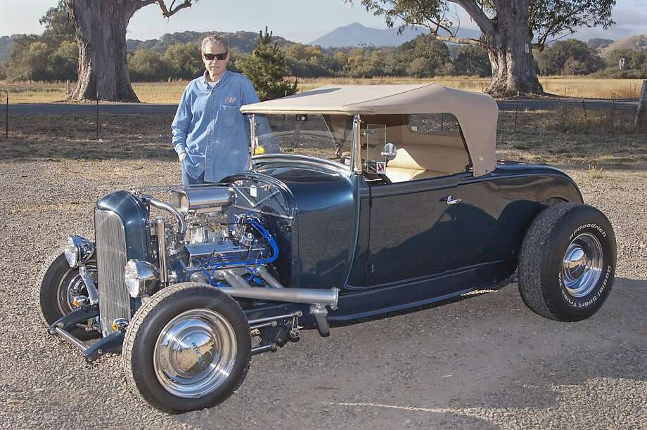 In 2010 Pat McGauley retired from the graphic arts industry and made the move from sunny Manhattan Beach, Ca. to even sunnier San Rafael. He is a proud owner of a 1929 Ford Hi-Boy Roadster, that looks exacly like the model he built when he was twelve. Photo: Stephen Finerty, Photograph By Stephen Finerty -
