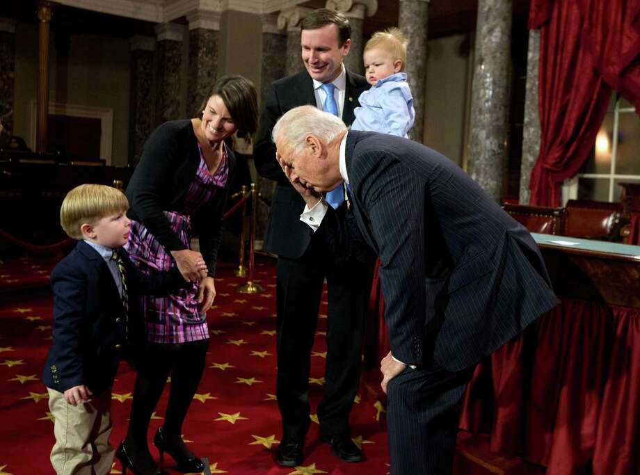 Vice President Joe Biden, center, jokes around with Owen Murphy, son of Sen. Chris Murphy, D-Conn., second from right, before a mock swearing-in ceremony for the 113th Congress, Thursday, Jan. 3, 2013, in the Old Senate Chamber on Capitol Hill in Washington.  From left are Owen; Murphy's wife Catherine Murphy, Biden, Murphy, and son Rider. (AP Photo/ Evan Vucci) Photo: Evan Vucci, ASSOCIATED PRESS / AP2013