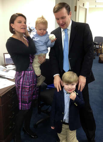 Family and friends of Chris Murphy gathered in Washington on Thursday for the swearing in of Murphy as the new senator from Connecticut. Murphy, with a temporary office in the basement of a Senate office building, greets his family, down from Cheshire, Conn., for the big day. Murphy and his wife, Cathy Holahan, are showing their two sons Owen, 3 years old, and Rider, 1, around the office. Photo: Charles J. Lewis/Hearst Newspape, Charles J. Lewis / Connecticut Post