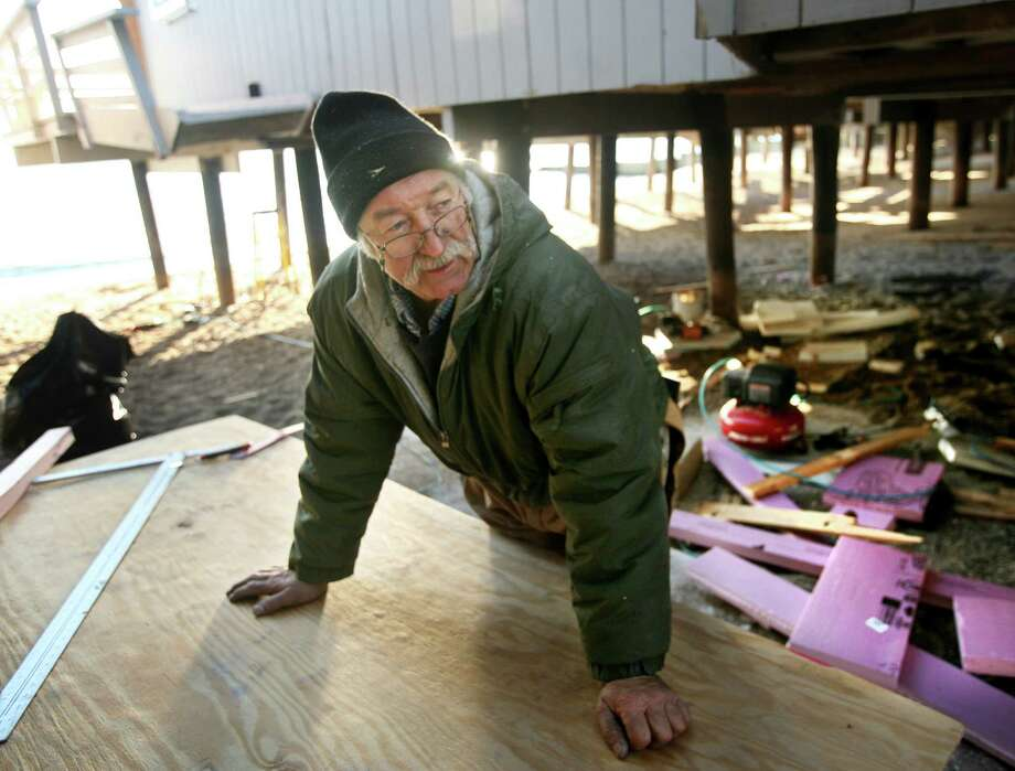 Edward Janus, owner of E.J. Home Improvement in Bridgeport, works to repair a home damaged by Hurricane Sandy on Shoreline Drive in the Lordship section of Stratford on Thursday, January 3, 2013. Photo: Brian A. Pounds / Connecticut Post