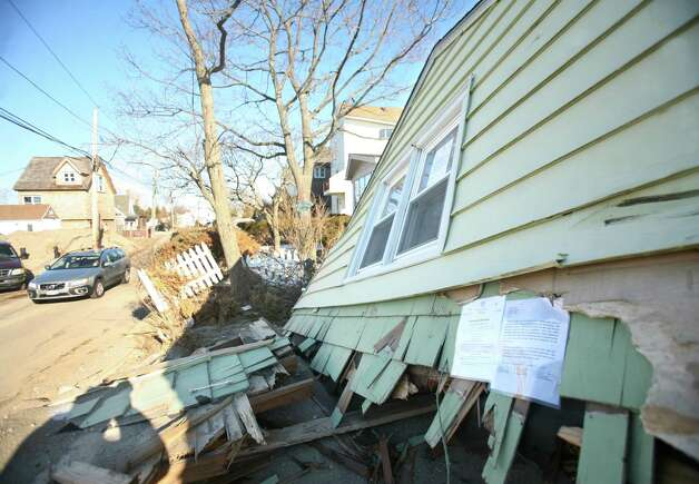 Letters from the town of Fairfield are posted on a house destroyed during Hurricane Sandy on Faifield Beach Road in Fairfield on Thursday, January 3, 2013. Photo: Brian A. Pounds / Connecticut Post