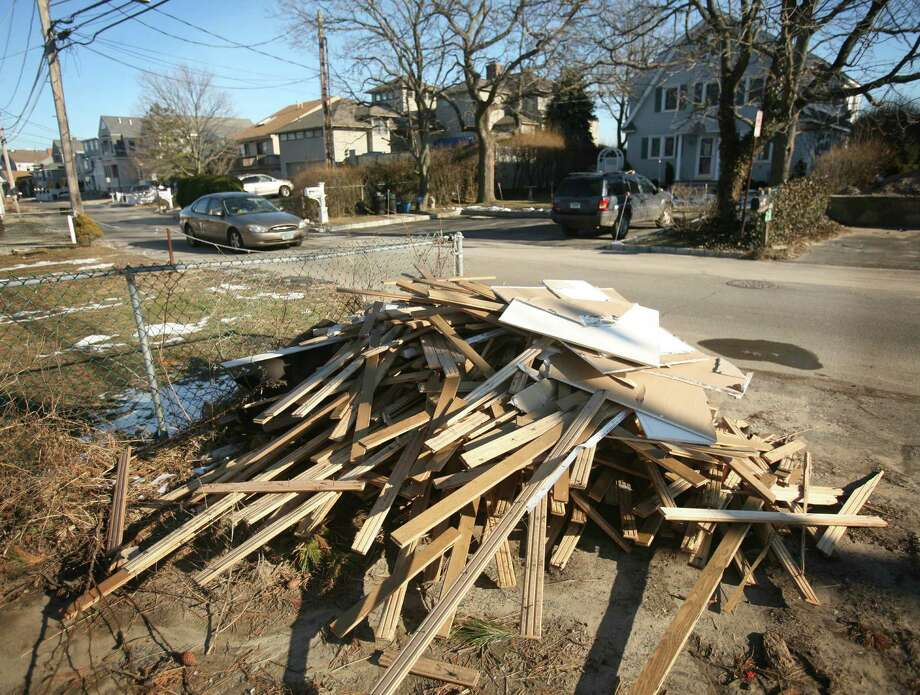 A pile of wood flooring, sheetrock, and other debris is piled along Fairfield Beach Road in Fairfield on Thursday, January 3, 2013. Photo: Brian A. Pounds / Connecticut Post