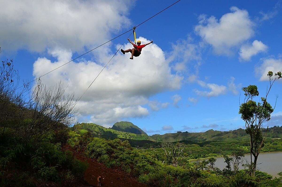 The recently completed eight-line Koloa Zipline tour includes a zip over Kauai's Waita Reservoir, the largest such body of water in the islands.