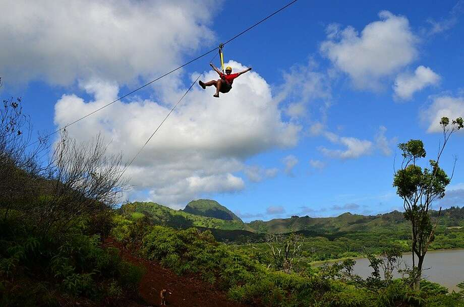The recently completed eight-line Koloa Zipline tour includes a zip over Kauai's Waita Reservoir, the largest such body of water in the islands. Photo: Koloa Zipline