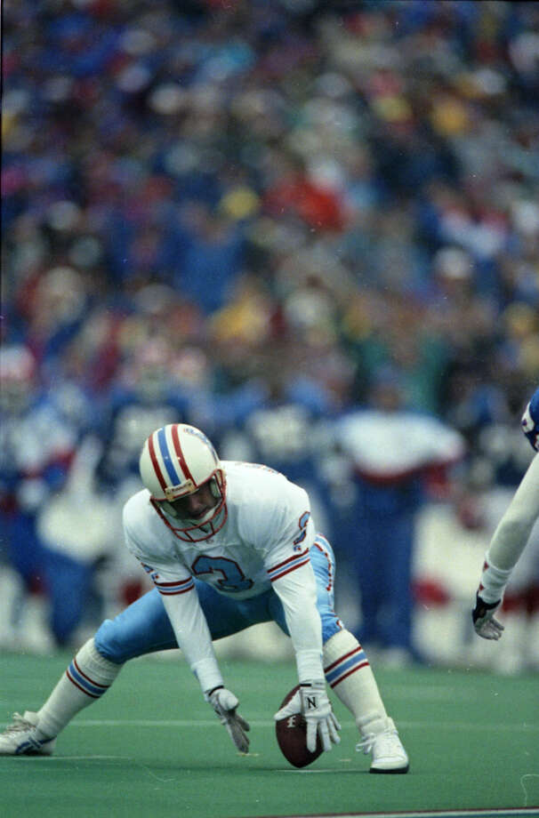 Oilers quarterback Warren Moon sits on the turf after throwing an interception in the third quarter in the AFC wildcard game against the Buffalo Bills.