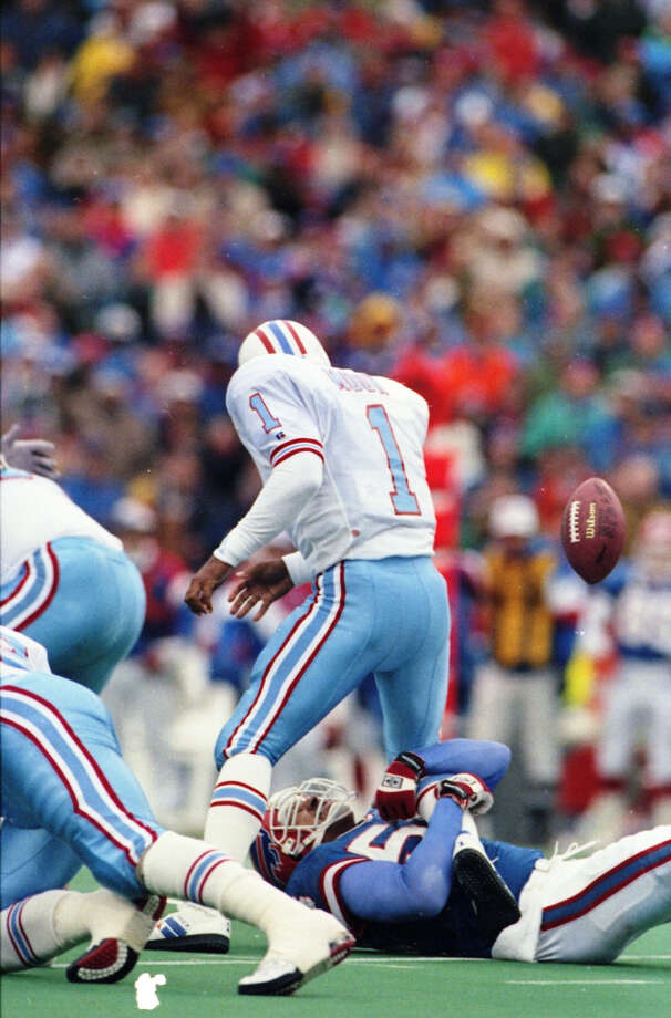 Oilers quarterback Warren Moon fumbles after being hit by Darryl Talley of the Bills in the third quarter.