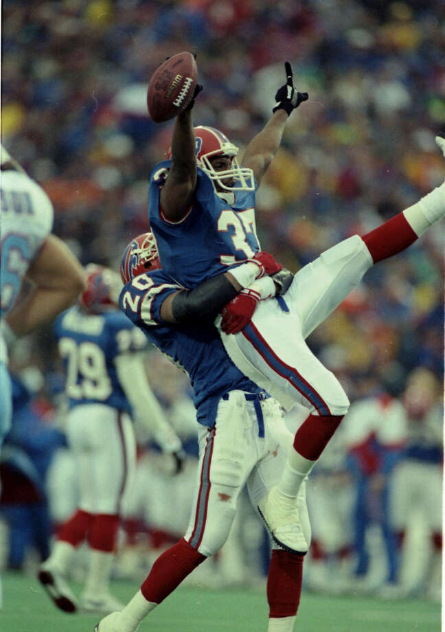 Nate Odomes of the Bills gets a lift from teammate Henry Jones after Odomes intercepted a Warren Moon pass in overtime to set up the winning field goal.