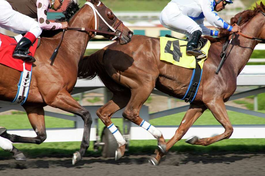 """In this image released by HBO, horses race in a scene from the HBO original series """"Luck.""""  The former director of the American Humane Association's Film and Television Unit sued HBO and the group on Monday, Dec. 31, 2012, claiming she was fired for complaining about the use of drugged, sick and underweight horses on the show """"Luck."""" (AP Photo/HBO, Gusmano Cesaretti) Photo: Gusmano Cesaretti"""