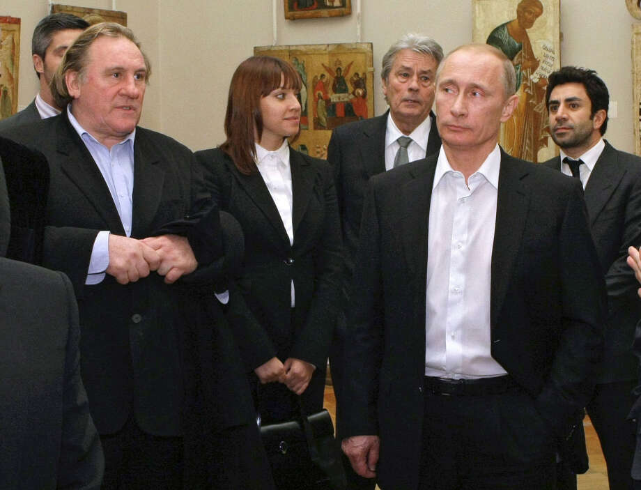 FILE - In this Saturday, Dec. 11, 2010 file photo Russian Prime Minister Vladimir Putin, right, and French actor Gerard Depardieu, left, attend the Russian Museum, in St. Petersburg. Gerard Depardieu, the French actor who has been sparring with his native country over taxes, has been granted Russian citizenship. A brief announcement on the Kremlin website said President Vladimir Putin signed the citizenship grant on Thursday Jan. 3, 2013. (AP Photo/RIA Novosti, Alexei Nikolsky, Pool) Photo: Alexei Nikolsky