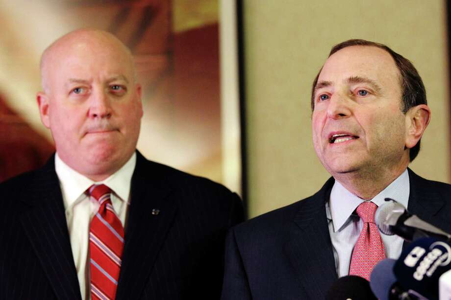 FILE - In this Dec. 6, 2012, file photo, NHL Commissioner Gary Bettman, right, and deputy commissioner Bill Daly speak to reporters in New York. Bettman has told the players union that a deal must be in place by Jan. 11 in order for a 48-game season to be played beginning eight days later.(AP Photo/Mary Altaffer, File) Photo: Mary Altaffer