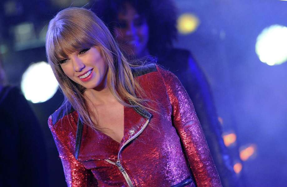 """It appears Taylor Swift has become pretty jaded about dating. She recently said in an interview that she never loved any of her past boyfriends, adding that she wound up waiting around for their publicists to tell them """"this isn't a good idea.""""Take a look at all the men Swift has pretended to like over the years. Photo: Mike Coppola, Getty Images / 2012 Getty Images"""