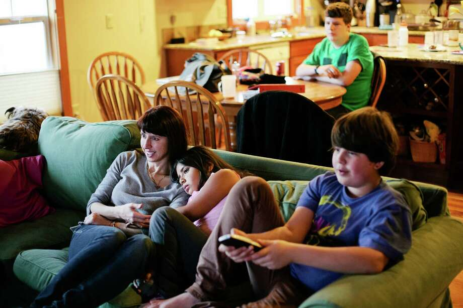 Lauren Myracle, a novelist, at home with her children in Fort Collins, Colo., Nov. 29, 2012. Myracle's novels take an uncensored look at the lives of children and teenagers, which has won her plenty of young fans, and lots of criticism from some older readers. (Benjamin Rasmussen/The New York Times) -- PHOTO MOVED IN ADVANCE AND NOT FOR USE - ONLINE OR IN PRINT - BEFORE DEC. 30, 2012. Photo: BENJAMIN RASMUSSEN / NYTNS
