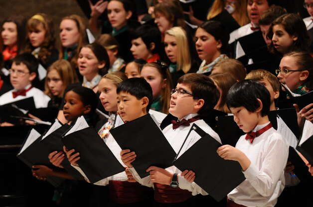 Members of the Capital District Youth Chorale sing during a 2011 holiday concert at St. Paul's Episcopal Church in Albany. (Times Union archive)