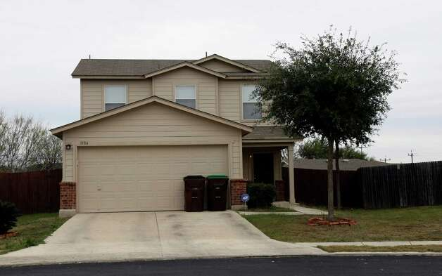 This is the western Bexar County home where Cynthia Jean Goodrum was shot to death. She'd been dragged into the house by the hair and was killed in the kitchen. Photo: Helen L. Montoya, San Antonio Express-News / ©SAN ANTONIO EXPRESS-NEWS