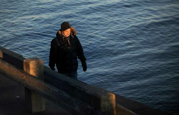 Patrick Grady, of Bridgeport, takes a walk along the Long Island Sound at St. Mary's By the Sea in Bridgeport, Conn. Thursday, Jan. 3, 2013. Photo: Autumn Driscoll / Connecticut Post