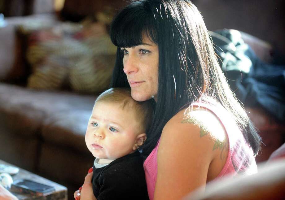 Kristen Deitz, of Fairfield, talks about her plans following the closure of Butler Business School in Bridgeport where she was a student.  Deitz holds her 5-month-old son, Joseph, at her home in Fairfield Thursday, Jan. 3, 2013. Photo: Autumn Driscoll / Connecticut Post