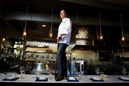Jeff Axline, chef and founder of the Brooklyn Athletic Club, Thursday, Dec. 20, 2012, on the bar of his new restaurant in Houston. ( Nick de la Torre / Houston Chronicle )