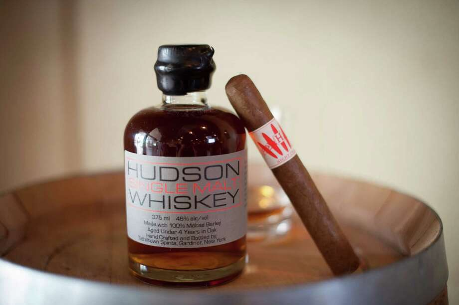 Houston's Hight Cigars is offering a medium-bodied cigar that has been barrel aged for eight months in a Hudson Bourbon barrel (charred American Oak). Photo: Patrick Bertolino, Houston Real Estate Photographer / 2011 PEB