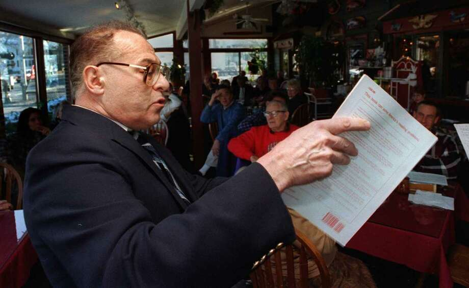 In this file photo Dr. Robert Fand addressing a breakfast gathering honoring his political activism. Photo: File Photo\Dave Harple, File Photo\David Harple / The News-Times File Photo