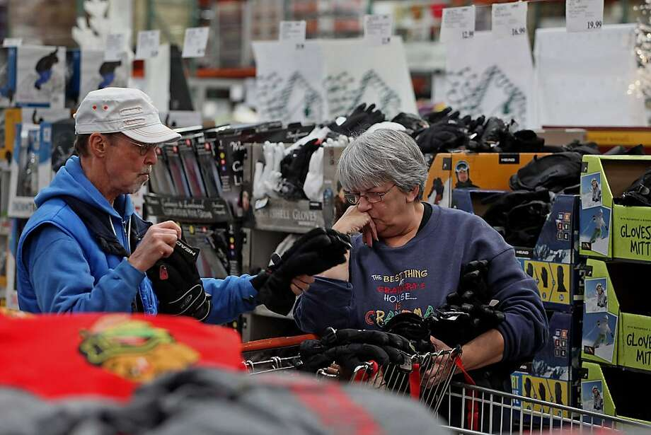 Customers at Costco in December were part of a 4.5 percent revenue rise for major retailers over December 2011. Sales spiked late in the month. Photo: Tim Boyle, Bloomberg