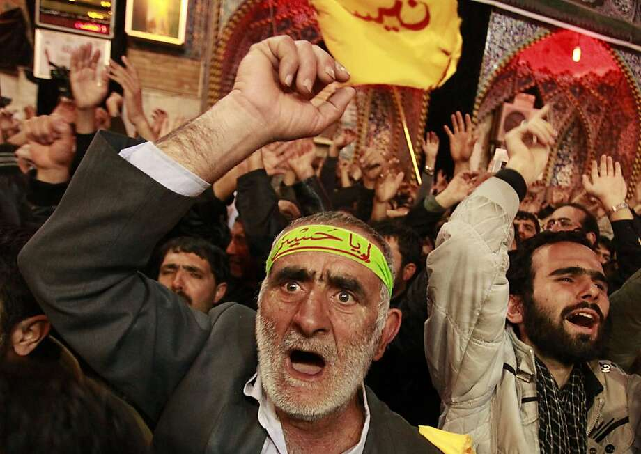 Shiites react during the Muslim festival of Arbaeen at the shrine of Imam Hussein in Karbala, south of Baghdad. Photo: Hadi Mizban, Associated Press