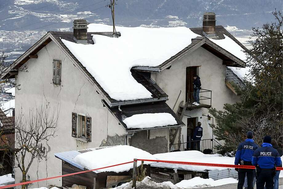 Policemen investigate the house of the gunman and the shooting scene after a shooting in Daillon, Switzerland, Thursday, Jan. 3, 2013. A man shot and killed three people and wounded another two in the Swiss village, and was then arrested by officers who shot and injured him, police said Thursday. Police in the southern canton (state) of Valais said they were alerted to the shooting in the village of Daillon just before 9 p.m. (20:00GMT) Wednesday. Three of the victims died at the scene and the two injured people were taken to hospitals. A police statement early Thursday gave no detail on their injuries. (AP Photos/Keystone, Laurent Gillieron) Photo: Laurent Gillieron, Associated Press