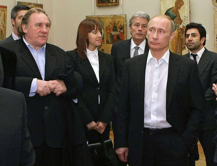 French actor Gerard Depardieu (left) visits Russian leader Vladimir Putin in 2010. Depardieu has been granted citizenship in honor of his cultural achievements, a Putin spokesman says. Photo: Alexei Nikolsky, Associated Press