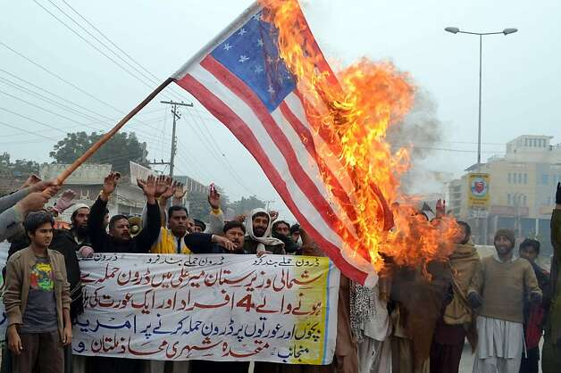Pakistanis burn a U.S. flag to protest drone attacks that they say kill civilians and violate Pakistan's sovereignty. Photo: S.s Mirza, AFP/Getty Images