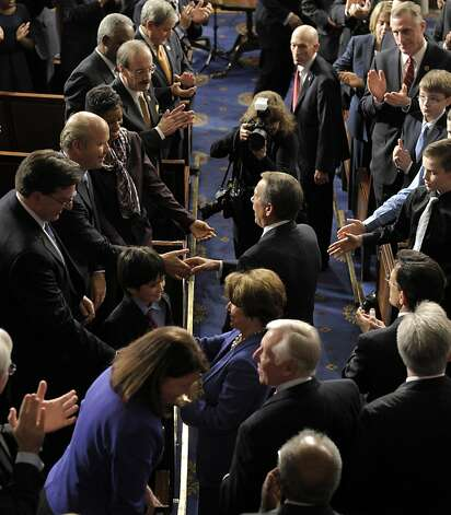House Speaker John Boehner of Ohio, center, followed by House Minority Leader Nancy Pelosi of Calif., and House Minority Whip Steny Hoyer, D-Md., shakes hands as they arrive in the House of Representatives chambers on Capitol Hill in Washington, Thursday, Jan. 3, 2013, after they were re-elected as their current titles for the 113th Congress. (AP Photo/Susan Walsh) Photo: Susan Walsh, Associated Press
