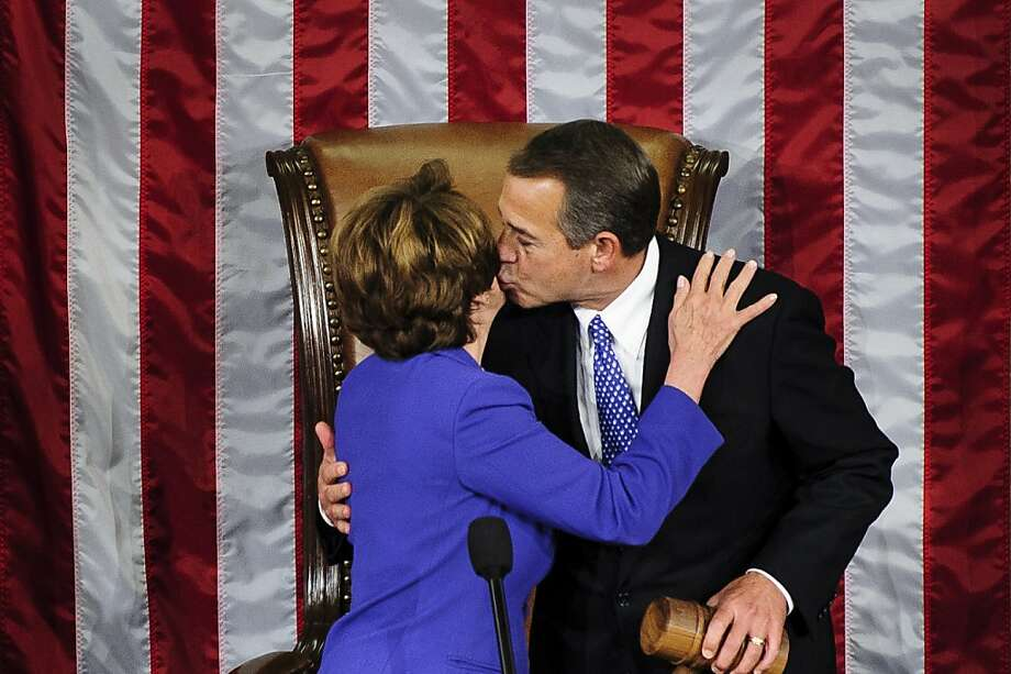 Ohio Republican John Boehner kisses Nancy Pelosi after being elected to a second term as speaker of the House. His 220-vote total matched the lowest for a speaker in 14 years. Photo: Pete Marovich, Bloomberg