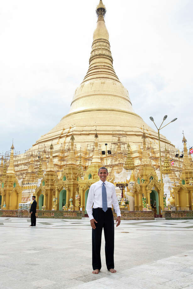 Nov. 19, 2012To some, this is just a snapshot and doesn't belong in this gallery of candid photographs from the year. But to me, it evokes what the trip to Burma was all about. Here is the President, shoes and socks off in respect, posing like an American tourist in front of the oldest pagoda in the world in a country that no U.S. President had ever been able to visit.President Barack Obama stands barefoot in front of the 368-foot tall Shwedagon pagoda in Rangoon, Burma, Nov. 19, 2012. (Official White House Photo by Pete Souza)
