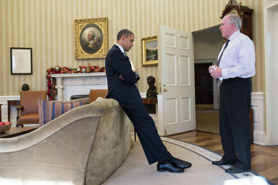 Dec. 14, 2012The President reacts as John Brennan briefs him on the details of the shootings at