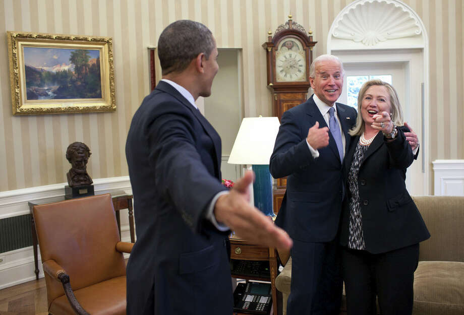 Jan. 30, 2012This is one of those rare instances where my presence indirectly became a part of this reaction from those pictured in the photograph. Secretary of State Hillary Clinton had just accidentally dropped all of her briefing papers onto the Oval Office rug and she, the President and Vice President all reacted in a way that indicated that surely I wouldn't get a photo of that to embarrass her. (Official White House Photo by Pete Souza)