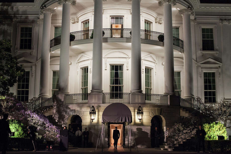 March 30, 2012We had just arrived aboard the Marine One helicopter on the South Lawn and the President was walking into the White House. I had seen this scene several times but had never been able to quite capture it the way I wanted. Here, finally, arriving at night, I was able to frame him walking into the light of the Diplomatic Reception Room, with the added bonus of his shadow being cast from the television lights off to the left. (Official White House Photo by Pete Souza)