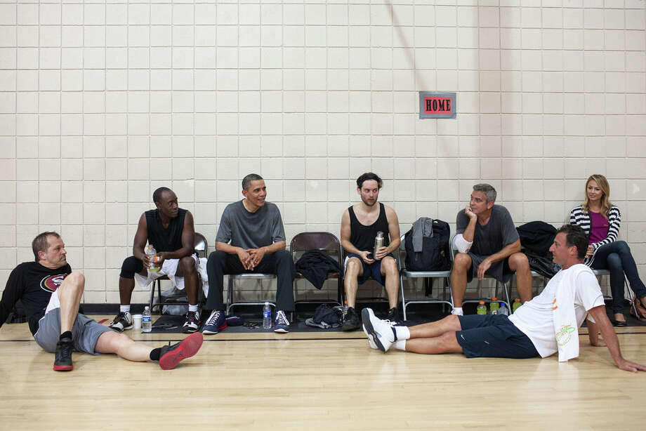 May 11, 2012After some early morning basketball in Los Angeles, the President talks with the players who included actors Don Cheadle, Tobey Maguire, and George Clooney, along with two of Clooney's long-time friends. Stacy Keibler is also at right. (Official White House Photo by Pete Souza)