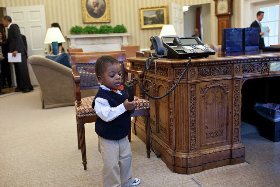 Feb. 7, 2012Kids will be kids. After the President had welcomed Lauren Fleming, the March of Dimes national ambassador, and her family in the Oval Office, her brother, Corbin Fleming, started to play with the President's telephone. Fortunately, he wasn't able to get through to a head of state. (Official White House Photo by Pete Souza)