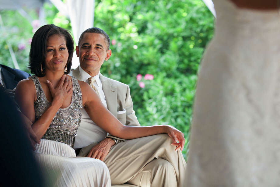 June 18, 2012The First Lady reacts as she watches Laura Jarrett and Tony Balkissoon take their vows during their wedding at Valerie Jarrett's home in Chicago. (Official White House Photo by Pete Souza)