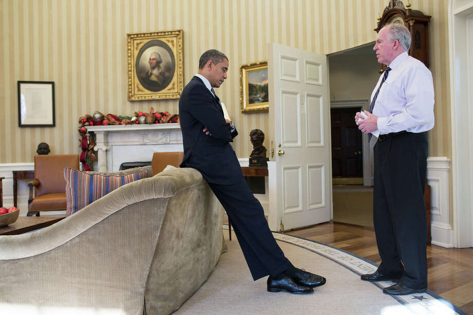 Dec. 14, 2012The President reacts as John Brennan briefs him on the details of the shootings at Sandy Hook Elementary School in Newtown, Conn. The President later said during a TV interview that this was the worst day of his Presidency. (Official White House Photo by Pete Souza)