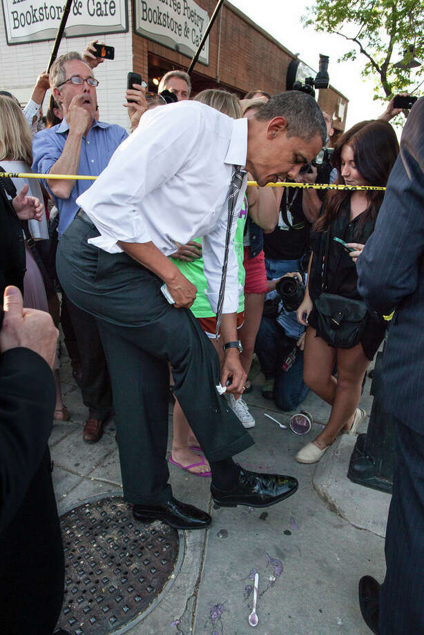 April 24, 2012The President wipes off his trousers after being splattered by frozen yogurt while shaking hands along a ropeline in Boulder, Colo. University of Colorado student Kolbi Zerbest had placed her cup of yogurt on the ground while trying to shake hands with the President, and someone else inadvertently kicked the cup. (Official White House Photo by Pete Souza)