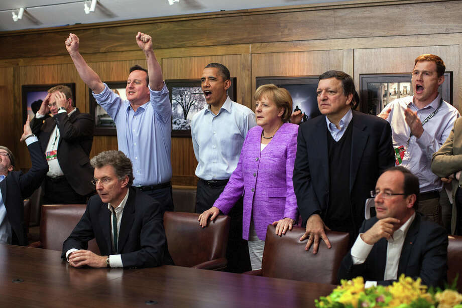 May 19, 2012At Camp David for the G8 Summit, European leaders took a break to watch the overtime shootout of the Chelsea vs. Bayern Munich Champions League final. Prime Minister David Cameron of the United Kingdom, the President, Chancellor Angela Merkel of Germany, José Manuel Barroso, President of the European Commission, French President François Hollande react during the winning goal. (Official White House Photo by Pete Souza)