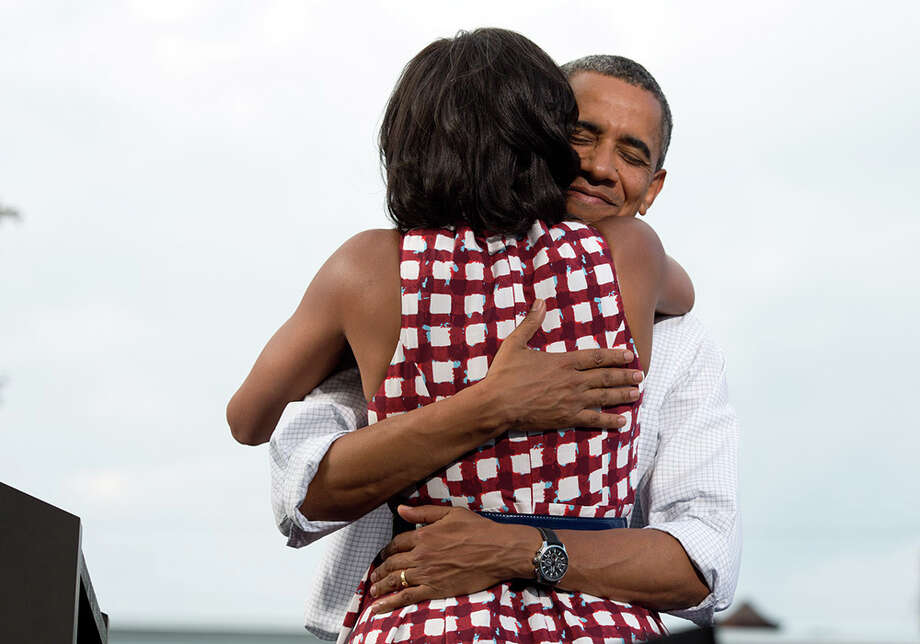 Aug. 15, 2012The President hugs the First Lady after she had introduced him at a campaign event in Davenport, Iowa. The campaign tweeted a similar photo from the campaign photographer on election night and a lot of people thought it was taken on election day. (Official White House Photo by Pete Souza)