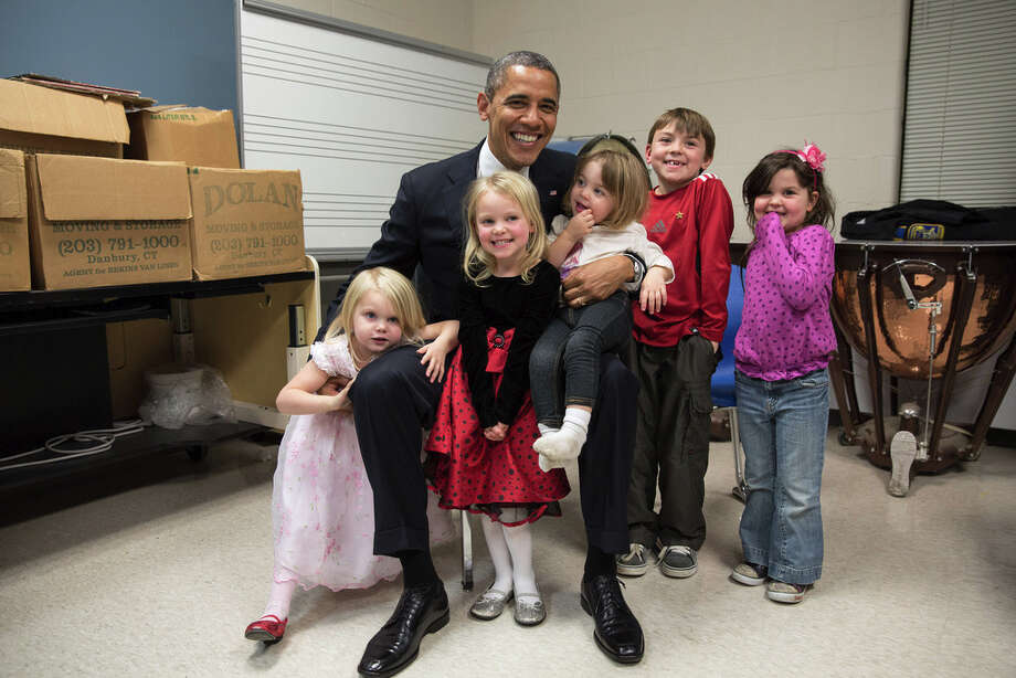 Dec. 16, 2012Two days after the shootings at Newtown, the President traveled to Connecticut to meet with the victims' families and give remarks at a prayer vigil. The President spent hours greeting family members. Difficult as that was for everyone, the one moment that helped sooth the pain was when he posed for a photo with the siblings and cousins of Emilie Parker, one of the 20 children who died that day in Newtown. I see both sadness and hope in this photograph, and I know after a lot of tears that day, it meant so much to the President that everyone was able to smile for a moment in this family photo. Thanks to the Parker family for allowing us to show this photograph publicly. (Official White House Photo by Pete Souza)