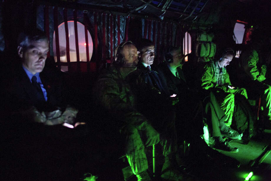 May 1, 2012In Afghanistan, there was virtually no light inside the helicopter as we flew from Kabul back to Bagram Air Field after the President had met with Afghan President Hamid Karzai. (For the photo buffs, this photograph was taken at ISO 6400, 1/5 second at f/1.4.) Flanking the President are General John Allen, Commanding General of U.S. Forces in Afghanistan, and U.S. Ambassador to Afghanistan Ryan Crocker. Denis McDonough, Deputy National Security Advisor, is at left. (Official White House Photo by Pete Souza)