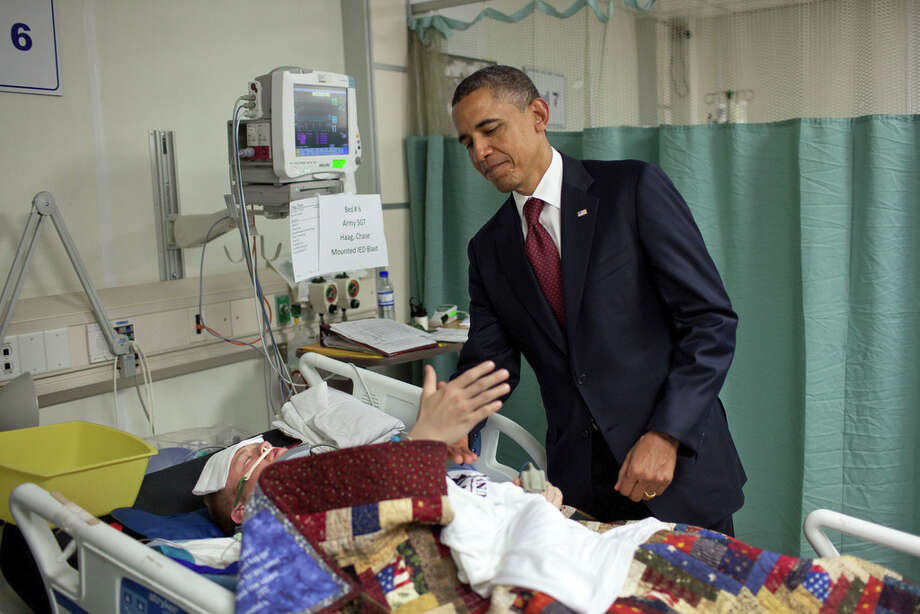 May 1, 2012For the President, this was one of the most poignant moments of the his first term. He was visiting wounded warriors in the intensive care unit at Bagram Air Field in Afghanistan. He had just presented a Purple Heart to Sgt. Chase Haag, who had been injured by an IED just hours before. Sgt. Haag was covered with a blanket and it was difficult to see how badly he was injured. He was also seemingly unconscious, or perhaps just asleep. The President whispered in his ear so not to wake him. Just then, there was a rustling under the blanket and Sgt. Haag, eyes still closed, reached his hand out to shake hands with the President. 'I'll never forget that moment,' someone else in the room later told me.(Official White House Photo by Pete Souza)