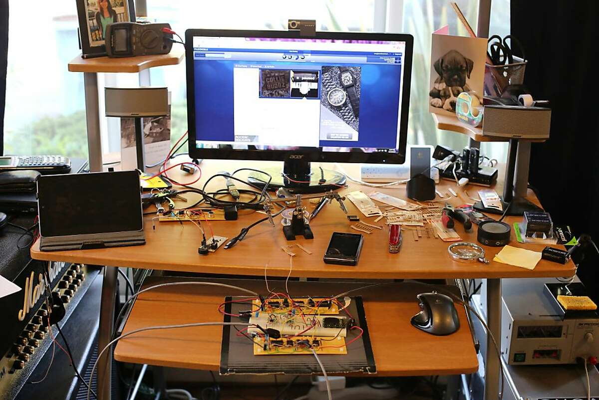 Sergiy Nesterenko's desk is covered in electronic components and wires as he works on a indoor positioning system for one of his classes final projects. Sergiy Nesterenko is one of a small number of students at UC Berkeley who is a triple major, majoring in math, physics and chemistry.