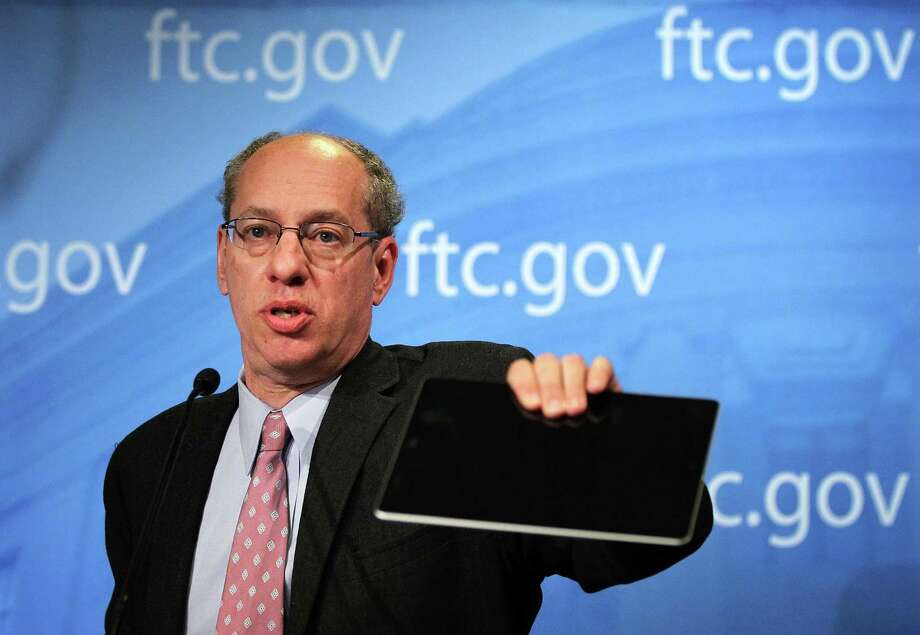 WASHINGTON, DC - JANUARY 03:  U.S. Federal Trade Commission Chairman Jon Leibowitz holds up an iPad as he speaks during a news conference regarding the agency's 21-month-long investigation on Google January 3, 2013 at the FTC headquarters in Washington, DC. FTC announced that Google has agreed to change some of its business practices, including giving competitors access to standard-essential patents and letting advertisers to get more flexibility to use rival search engines, to resolve the agency's competition concerns in the markets for devices like smart phones, games and tablets and in online searching.  (Photo by Alex Wong/Getty Images) Photo: Alex Wong, Staff / 2013 Getty Images