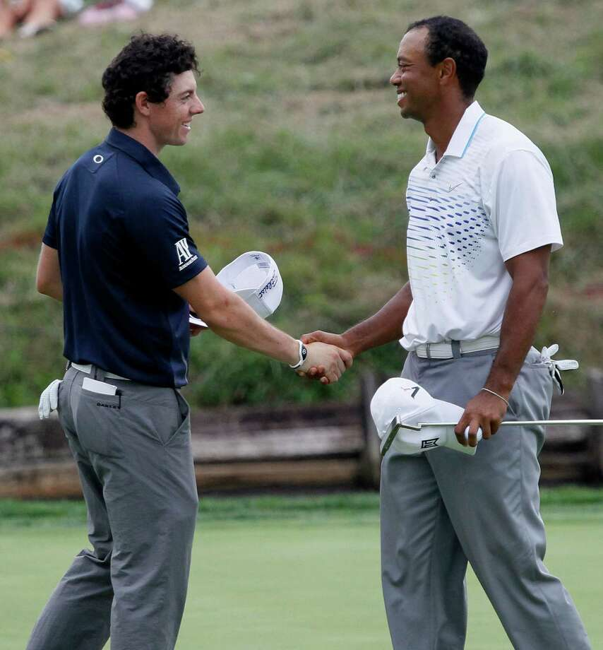 Current No. 1-ranked player Rory McIlroy, left, and the longtime holder of that distinction, Tiger Woods, likely will be the most scrutinized golfers this year. Photo: Charles Rex Arbogast, STF / AP