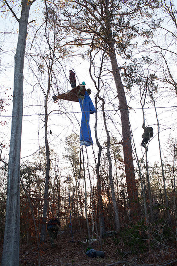 A activist identified only as Mike stands on a platform in trees  near Diboll, Texas on Jan. 3, 2013, to protest construction of the Keystone XL pipeline. Photo: Tar Sands Blockade