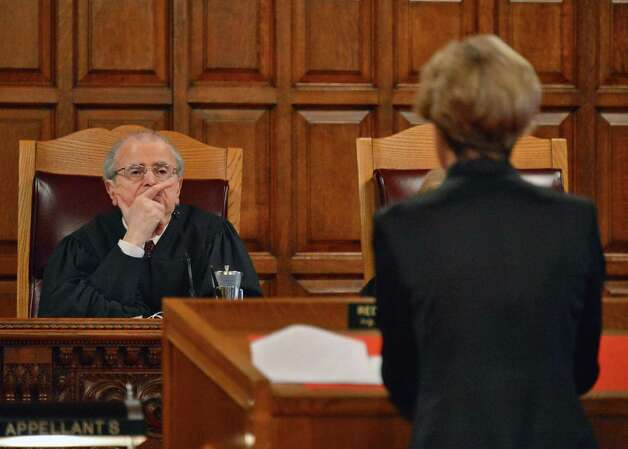 Court of Appeals Chief Judge Jonathan Lippman, left, listens to Beth Bourassa, representing the appellant School District, during arguments before the Court of Appeals Thursday Jan. 3, 2013, in Albany, N.Y., on the matter of Shenendehowa Central School District Board of Education v Civil Service Employees Association, Local 1000, AFSCME, AFL-CIO, Local 864. (John Carl D'Annibale / Times Union) Photo: John Carl D'Annibale / 00020638A